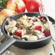 Chicken liver stewed with apples and onion — Stock Photo #39884041