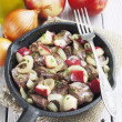 Chicken liver stewed with apples and onion — Stock Photo