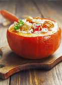 Chicken with rice and vegetables baked in the pumpkin — Stock Photo