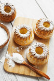 Homemade muffins powdered sugar  — Stock Photo