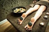 Massage with hot stones — Stock Photo