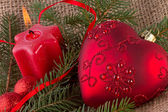 Christmas decoration with red heart and candle — Stock Photo