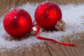 Christmas red balls on wooden background — Stock Photo