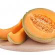 Royalty-Free Stock Photo: Sliced piece cantaloupe melon on wooden carving board