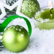 Green christmas balls with snowflakes — Stock Photo