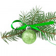 Green christmas ball with fir branch on white — Stock Photo