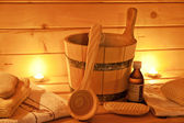 Interior of finnish sauna and sauna accessories — Stock Photo