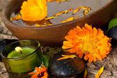 Spa concept with orange flowers — Stock Photo