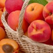 Fresh apricot in wicker basket in close up — Stock Photo