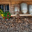 Stock Photo: Old milk cans on a shelve at a alpine hut
