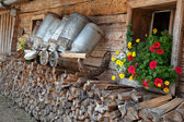 Nostalgic old milk cans in a alpine hut — Stock Photo