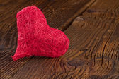 Red heart on old wooden board — Stock Photo