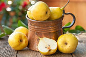 Ripe Pears with leaves on wooden table — Stock Photo