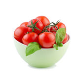 Tomato with basil leaves in green bowl — Foto Stock