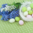 Easter Decoration with Spring Flowers and Eggs on Green Polka Dot Tablecloth — Stock Photo #44259303
