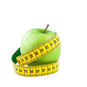 Healthy food and diet concept, green apple with measure tape — Photo