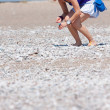 Woman collecting shells — Stock Photo