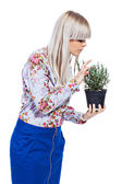 Beautiful girl with a rosemary plant — Stock Photo