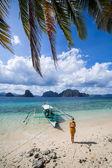 Woman on a perfect palm beach — Stock Photo