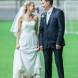 Wedding couple in soccer field — Stock Photo #32117485