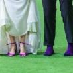 Wedding couple legs on soccer field — Stock Photo #32117499