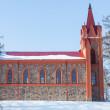 Red church in winter time — Stock Photo