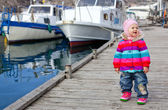 Toddler girl on sea background — Stock Photo