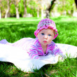 Little baby in green grass — Stock Photo