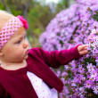 Baby girl with flowers  — Foto Stock