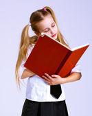 Schoolgirl reading the book — Stock Photo