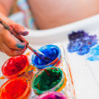 Little girl is painting — Stock Photo