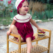 Toddler girl in hand made dress with cherries — Stock Photo