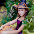 Shot of a little girl in halloween costume posing with pumpkin  — Stock Photo