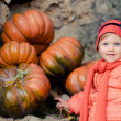Happy girl with pumpkins  — Stock Photo