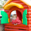 Portrait of toddler girl in play house outdoors — Stock Photo #39920733