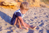 Cute little girl at the sand — 图库照片