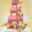 Three pink elephants in the sky with gifts and snowflakes. — Stock Photo