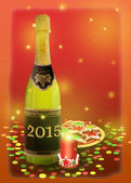 A bottle of sparkling white wine and Christmas decoration. — Stock Photo