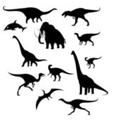 Silhouettes of prehistoric animals — Stock Vector