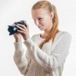 Young girl with digital camera, taking picture — Stock Photo #33293597