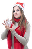Girl with the snowflake in her hand — Stock Photo
