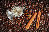 Composition with clock, cinnamon and star anise — Stock Photo