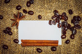 Visiting card with coffe, cinnamon and star anise — Stock Photo