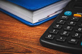 Notepad with calculator — Stock Photo