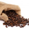 Sack with scattered coffee beans — Stock Photo