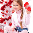 Stock Photo: Girl sitting on the floor near a white artificial Christmas tree with gifts