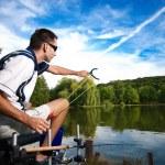 Sport fishing on a beautiful lake — Stock Photo #16914323