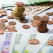 Different currency of paper euro money and coins — Stock Photo