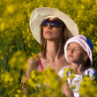 Beautiful young mother and her daughter relax — Stock Photo