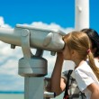 Mother and daughter looking through a telescope — Stock Photo